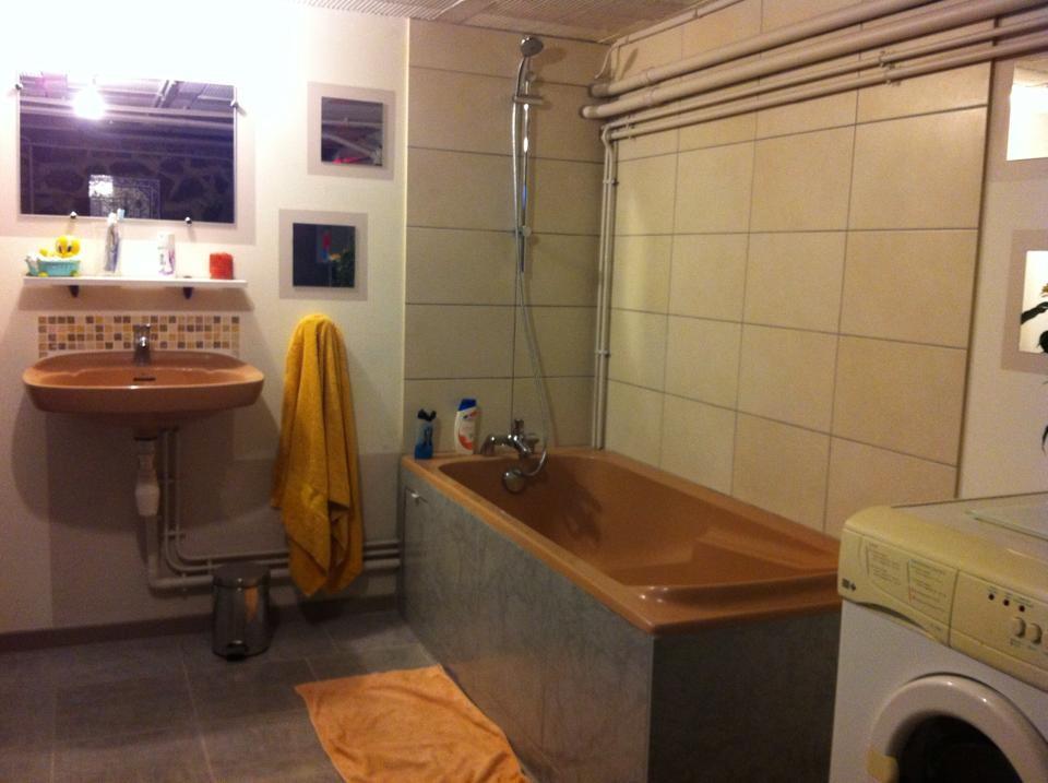 Chantier réalisé chez un particulier avec installation d'une baignoire et rénovation du sol carrelage